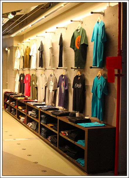 Industrial Display Systems T-Shirt Wall System - like hanging (you can see the shirts) and foldable storage