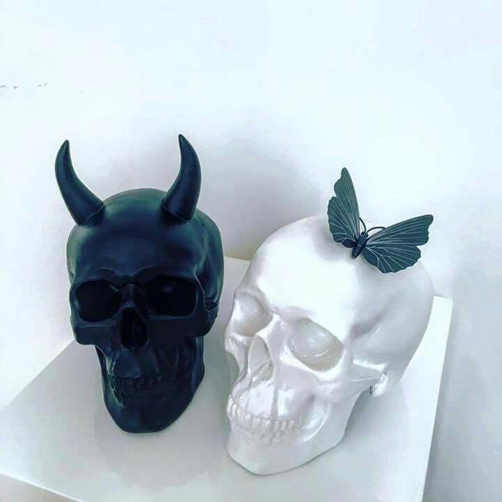 Devil skull & Angel (?) skull