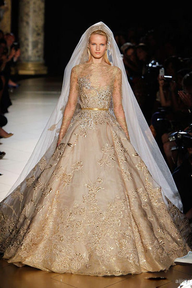 15 best gold wedding dress images on pinterest boyfriends bride elie saab gold lace beads wedding dresses with long sleeves appliqued ball gowns sheer bateau neck chapel train sequins bridal gown junglespirit Image collections