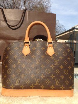 Louis Vuitton Alma Monogram Canvas Handle Brown Tote Bag. Get one of the hottest styles of the season! The Louis Vuitton Alma Monogram Canvas Handle Brown Tote Bag is a top 10 member favorite on Tradesy. Save on yours before they're sold out!