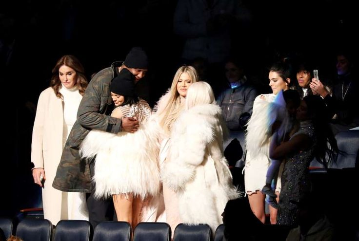 "Lamar Odom, second left, hugs Kylie Jenner as Caitlyn Jenner, left, Khloe Kardashian Odom, center, Kim Kardashian, Kendall Jenner, North West and Kourtney Kardashian (both out of spotlight) attend the unveiling of the Yeezy collection and album release for Kanye West's latest album, ""The Life of Pablo,"" Thursday, Feb. 11, 2016 at Madison Square Garden in New York."