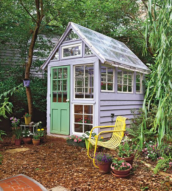 Potting Shed with Salvaged Parts - A whimsical backyard structure, this custom greenhouse is comprised of found windows of varying sizes. The solar-panel roof heats the interior, and a stained-glass window offers a bit of decorative style. Periwinkle blue walls and a neon green door add garden-fresh color to this one-of-a-kind backyard structure.
