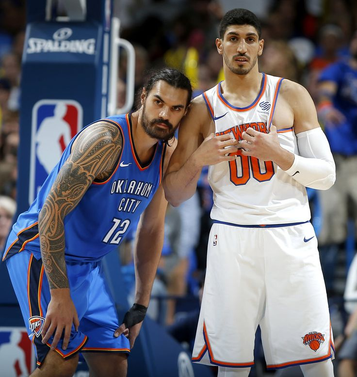 Oklahoma City\'s Steven Adams (12) and New York\'s Enes Kanter (00) stand next to each other during an NBA basketball game between the Oklahoma City Thunder and the New York Knicks at Chesapeake Energy Arena in Oklahoma City, Thursday, Oct. 19, 2017. Photo by Bryan Terry, The Oklahoman