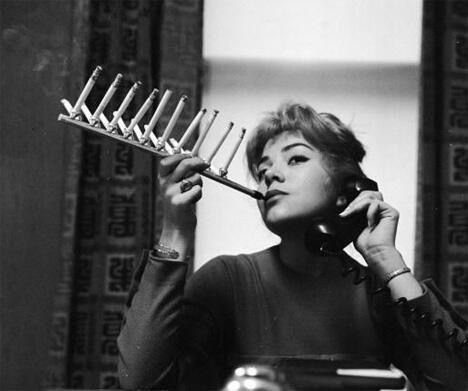 Why smoke one cigarette when you can smoke the pack at once, 1950's.
