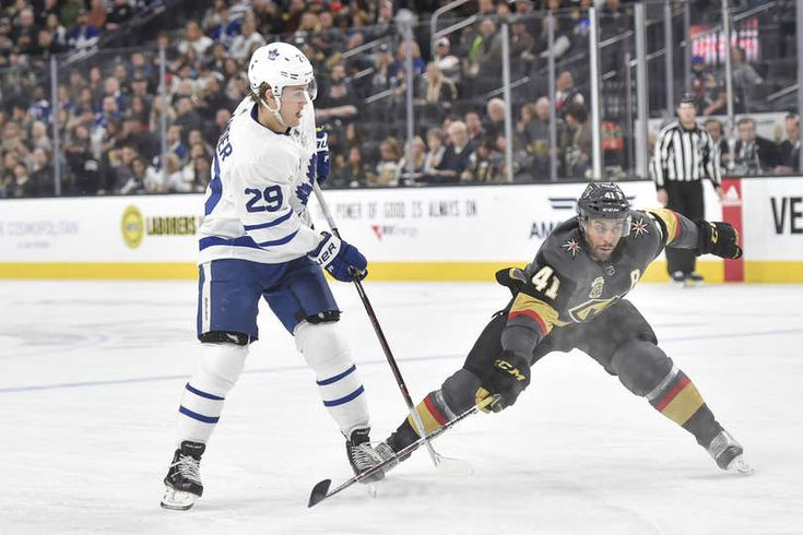 William Nylander #29 of the Toronto Maple Leafs passes the puck with Pierre-Edouard Bellemare #41 of the Vegas Golden Knights defending during the game at T-Mobile Arena on December 31, 2017 in Las Vegas, Nevada