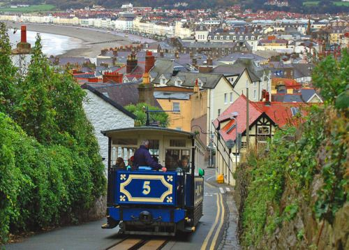 The Great Orme Tramway in Llandudno, Wales, climbs one mile to the Ormes summit and offers breathtaking views of Llandudnos magnificent bays. It is Great Britains only remaining cable operated street tramway; and one of only three left in the world. It is also a most fetching shade of blue. (Danielzolli on flickr)