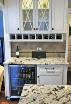 "Closet wine bar w/beverage fridge and 1 cabinet. I plan to do this but with 12"" 3 drawer base cabinet. Like the glass doors & wine rack above. I'm adding cup rack as well."