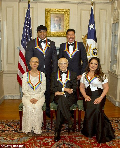 Singers Lionel Richie (top right) and Gloria Estefan (bottom right), rapper turned actor LL Cool J (top left), producer Norman Lear (bottom center) and dancer Carmen de Lavallade (bottom right) are pictured at the US Department of State in Washington, D.C. on Saturday