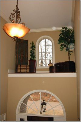 Two Story Foyer Ledge Decorating Stack Of Luggage Or Crates A Chest