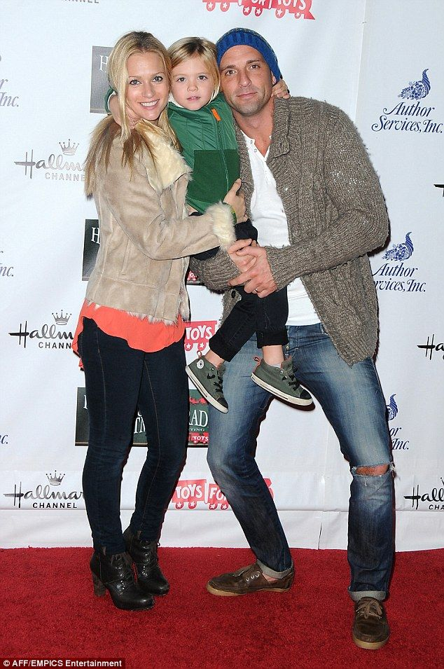 Soon they will be a family of four: Cook, Andersen and son arriving at the 2012 Hollywood Christmas Parade in Hollywood