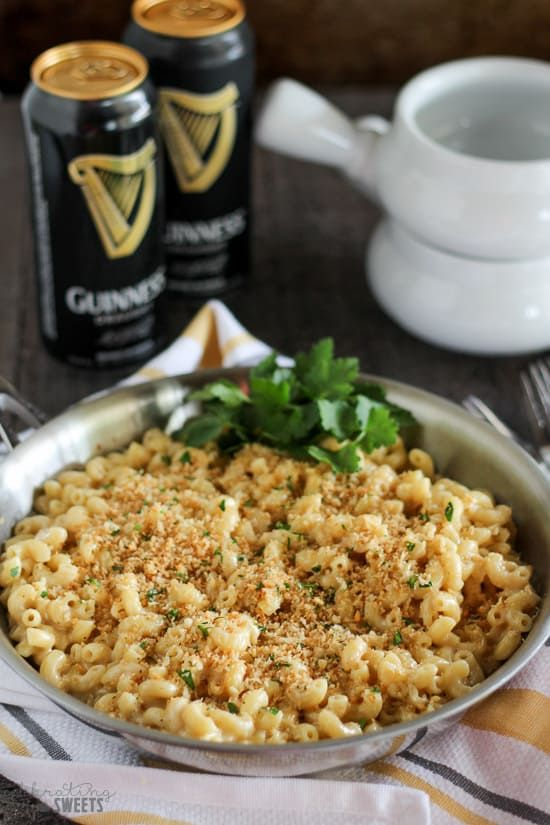 Guinness and Irish Cheddar Macaroni and Cheese - Stovetop macaroni and cheese filled with Guinness stout, sharp Irish cheddar and a touch of dijon mustard. Creamy and cheesy with a crunchy garlic breadcrumb topping. #macandcheese #macaroniandcheese #pasta #dinner #guinness #stout #stpatricksday