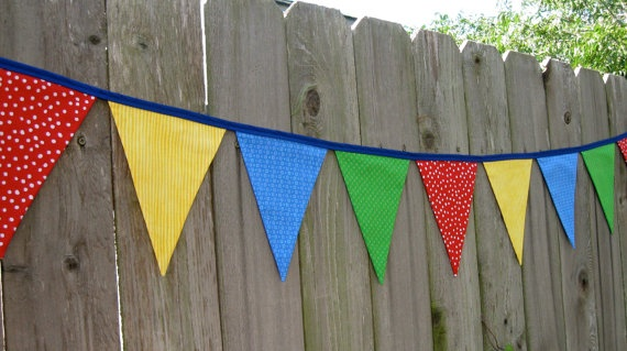Primary Colors - Fabric Bunting Banner - Sesame Street - Classroom - Circus - Nursery - Room Decor - Red Yellow Blue & Green - 9 Large Flags. $30.00, via Etsy.