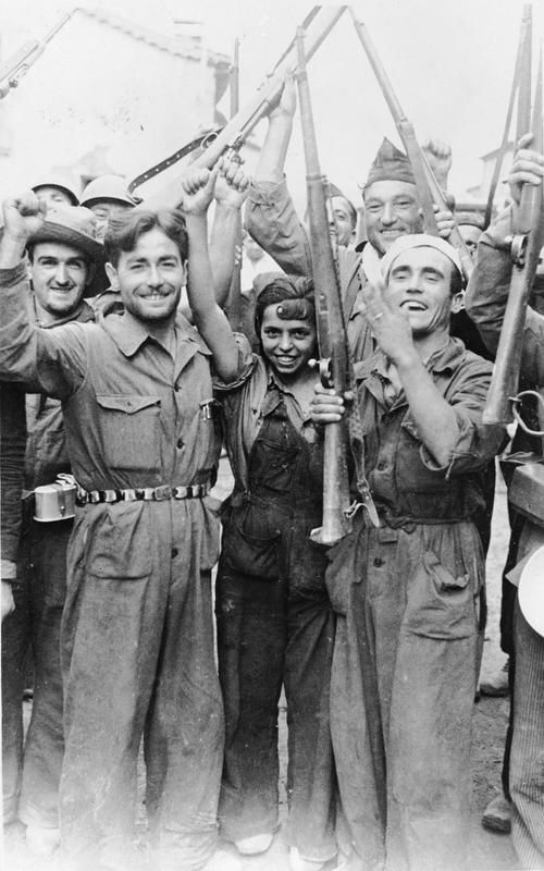SPANISH CIVIL WAR 1936-1939 (HU 32986) Republican militiamen with a local girl near the Aragon Front in 1936 during the Spanish Civil War.