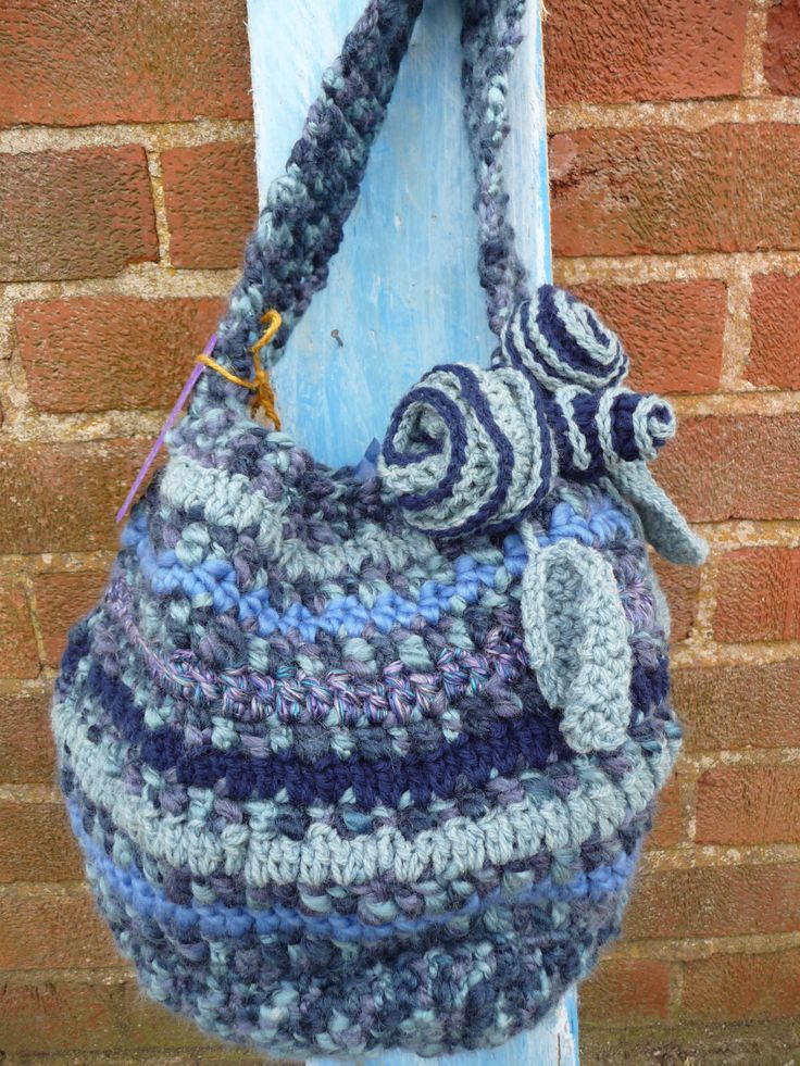 Blue multi crocheted bag with floral decoration. £15