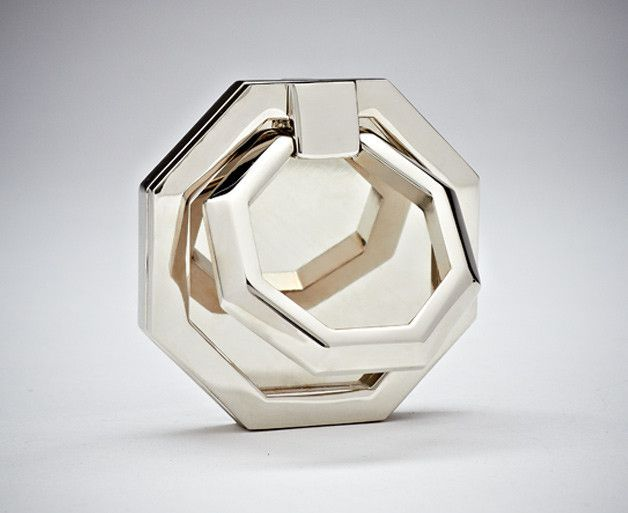 From our signature hardware line, this octagonal pull references the simple details of the streamline moderne style and giv es a nod t o nautical machinery. The faceted shape and angled planes make it