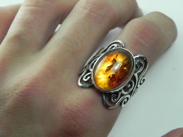 Amber Ring - Baltic Amber Swirl Ring - Unique Silver Amber Jewelry - Antique Swirls - Vintage Inspired Filigree. $159.00, via Etsy.