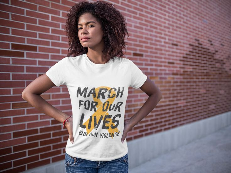 """Show your support in the stand against gun violence by wearing """"March For Our Lives"""" Orange Gun Violence Awareness Ribbon shirt.  Hoodies and stickers available."""
