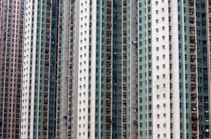 Residential buildings stand in the Tin Shui Wai area in Hong Kong on March 3, 2012. (Jerome Favre/Bloomberg News)#