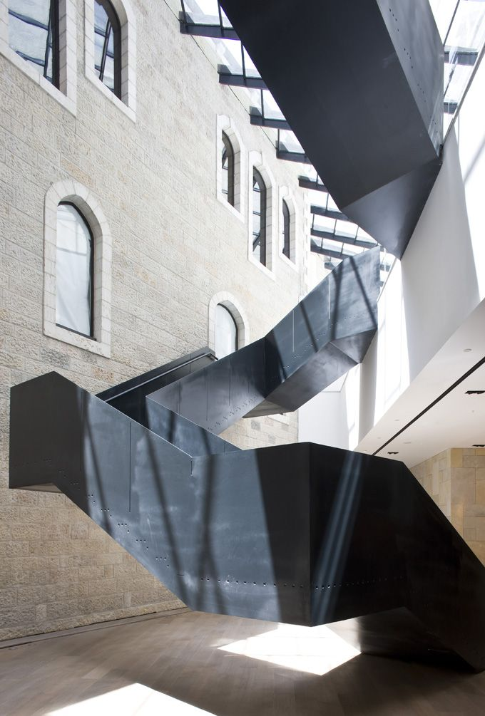 Amazing modern staircase mixes elegantly with the historical walls of Jerusalem at the Mamilla Hotel.