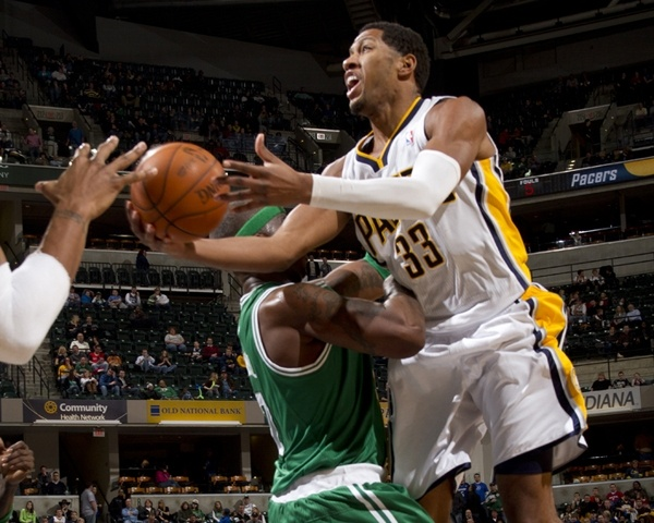 Pacers forward Danny Granger collides with the defense of Boston center Jermaine O'Neal