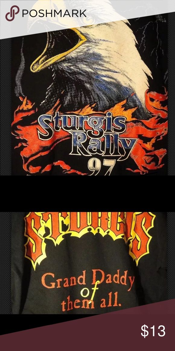 "Sturgis Vintage  1997 Motorcycle Rally T Shirt LG This is a Sturgis 1997 Motorcycle Rally T Shirt.   The shirt is Lightly Used and in EXC COND   It is a size Large but fits more like a Medium since it's vintage.   Primary color is Black   Measurements:   Pit to Pit: @ 21""   Collar to Hem: @ 26"" Tops Tees - Short Sleeve"