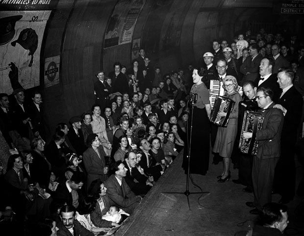 1940:  Members of the public being entertained by an ENSA concert party in Aldwych Underground Station