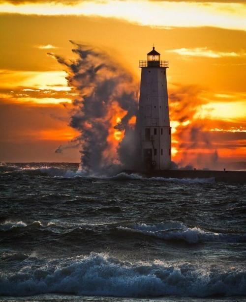 Waves crashing against lighthouse