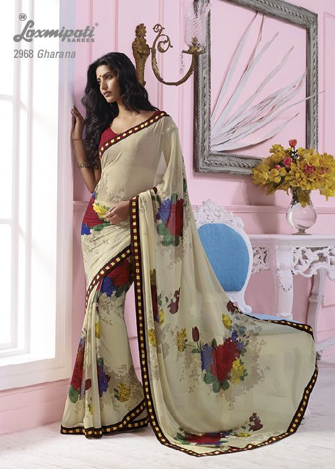 This off white marble chiffon material saree with red & yellow color border & with multi flowers prints.