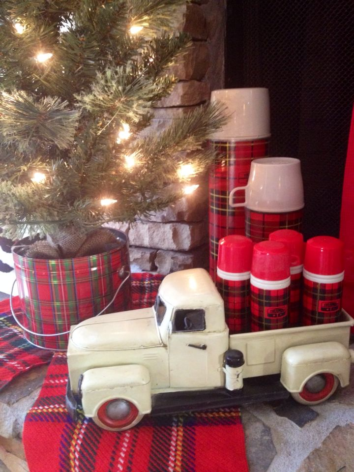 I love plaid thermoses! Couldn't resist displaying my minis (actually vintage Avon cologne bottles) in the back of a toy truck this Christmas!