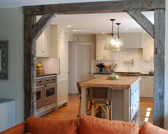 Reclaimed beams and lumber set up in doorways like this and as shelving with vintage industrial mounts can get you some of that old wood richness, without commiting to that full blown barnwood wall.
