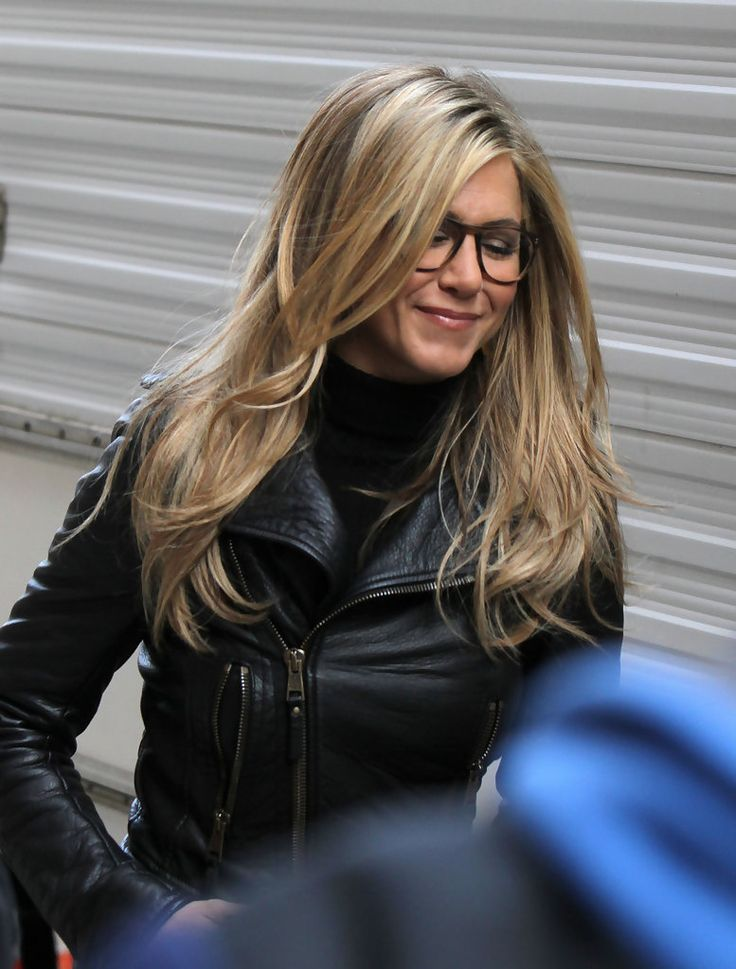 "Jennifer Aniston Lookbook: Jennifer Aniston wearing Knee High Boots (1 of 7). Jennifer Aniston filmed scenes for her new film ""Wanderlust"" in black suede knee high boots. She paired the slouchy boots with black tights, and a leather jacket and skirt."