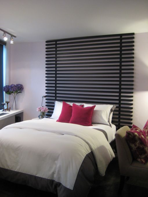Easy, modern, DIY headboard.   Create it by using 1-1/2-inch MDF pieces secured to two strips of iron. Extend it to the ceiling to add height to the room and create a focal point.  Simple yet dramatic.....