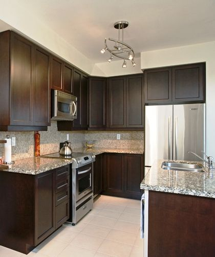 Accommodation for Microwave over Range, Deep Cabinet over Fridge, Granite Counter, Extended Upper Cabinets