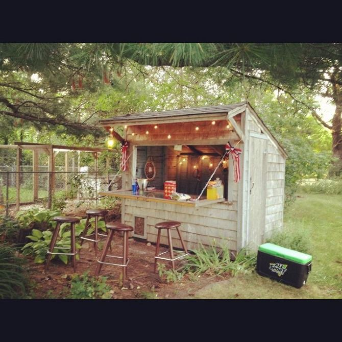 This is a great small rustic bar shed complete with fun lights and bar stools.