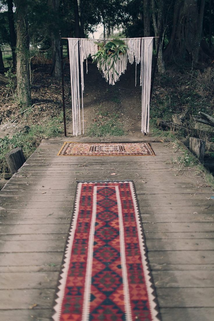 Our Persian rug aisle and macrame wedding backdrop Hummingbird Style and Hire.   Images Juddric Photography | Bride's Dress Rue De Seine | Bride's Shoes R.M. Williams | Groom's Suit Jack London | Groom's Shoes The Horse | Celebrant Erin Woodhall | Flowers