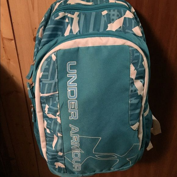 Women's Under armour backpack gently used. Blue and white backpack that's been gently used does have stain on handle and some damage on the bottom of bag. Under Armour Bags Backpacks
