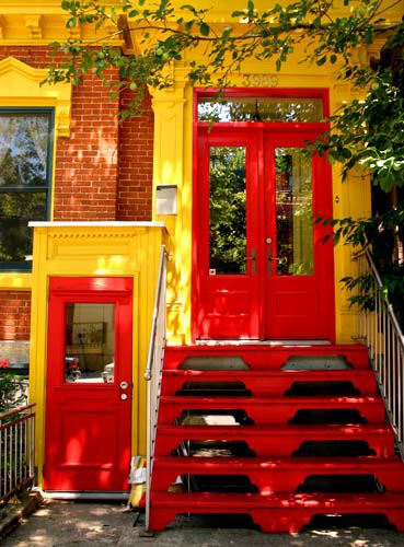 Bright red door, entry and stairs.
