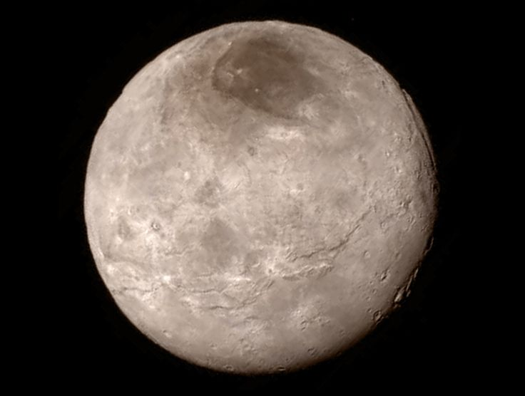 Crisp new view of Pluto's largest moon, Charon shows a swath of cliffs and troughs stretches about 600 miles (1,000 kilometers) from left to right, suggesting widespread fracturing of Charon's crust, likely a result of internal processes. At upper right, along the moon's curving edge, is a canyon estimated to be 4 to 6 miles (7 to 9 kilometers) deep.  Credit: NASA-JHUAPL-SwRI