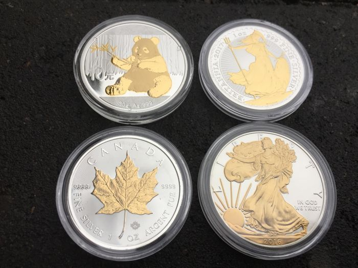 China  Groot-Brittannië Canada  Amerika - 4 x 1 oz - Chinese Panda 2017 - Britannia 2017  Maple Leaf 2016  zilveren adelaar 2016 met 24-karaats gouden Finish  Internationale zilveren munt set - 4 van's werelds meest beroemde beleggingsmunten - allemaal met een 24 karatGouden finish! Wereldwijd limited edition van slechts 5000 stuks elk!1 x China panda 2017-999 zilver met 24 karat gold finish - uitgave van 5000 stuks1 x Britannia 2017 - 999 zilver met 24 karaat gouden afwerking - editie van…