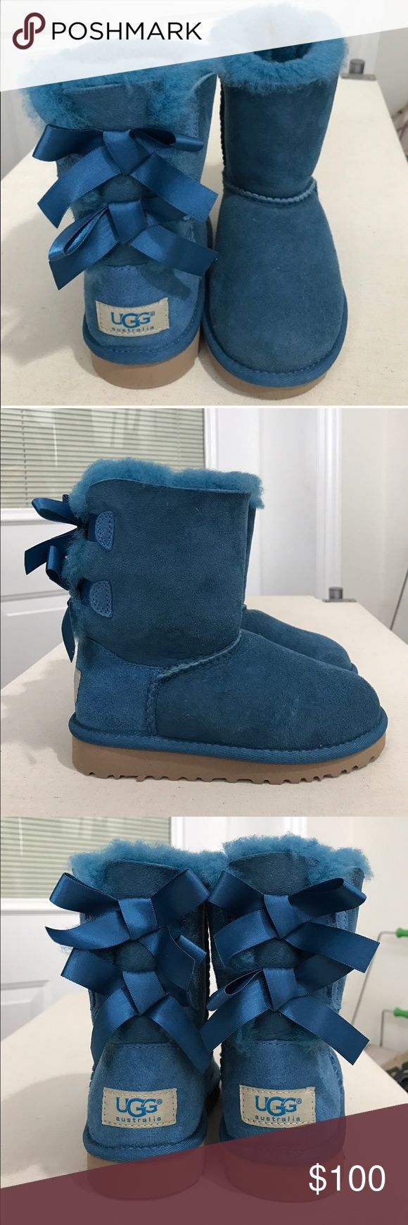 Children's UGG Bailey boots with bows These super cute teal Ugg boots have never been worn! So warm and fuzzy and perfect for any little fashionista!!!! Comes from a home with dogs so may have tiny hairs that traveled through the air.  Does not come with box. Firm on price. Thank you :) UGG Shoes Boots