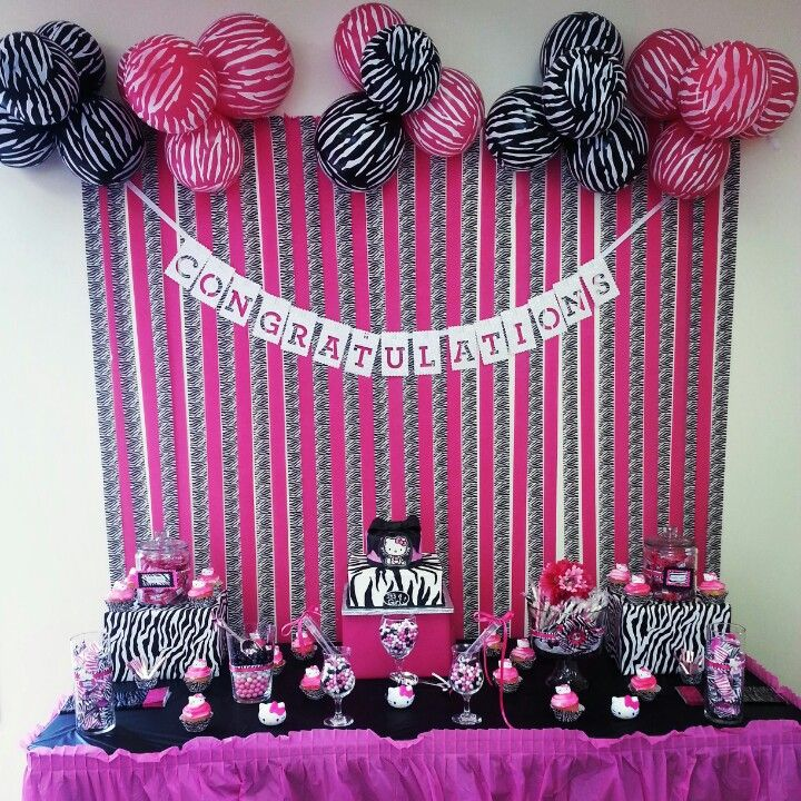 Hello kitty and zebra print candy buffet table baby for Animal print baby shower decoration ideas