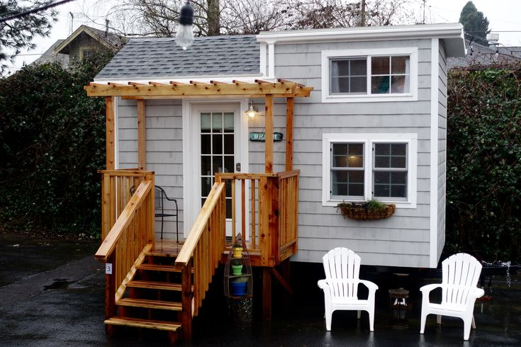 """The """"Tiny Beach House"""" is a bright and airy 16-foot Tiny House on wheels available for rent at the Tiny Digs Hotel in Portland. Watch the video tour!"""