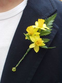 Daffodil boutineers wouldnt last very long not a fan of the leather fern but i LOVE how the base was treated with the wire & bead