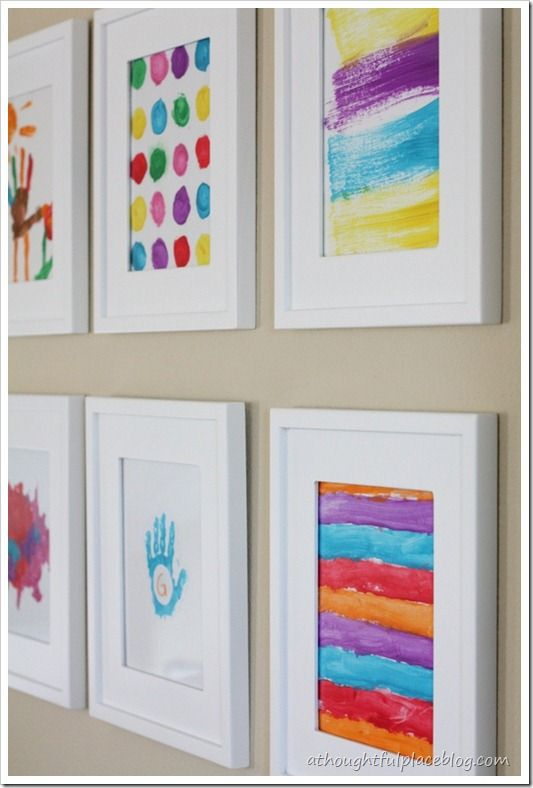 Kids' art gallery wall ~ in hallway between kids' rooms