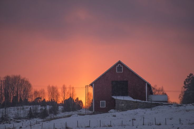 Sunset behind a barn