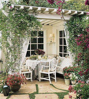 With the addition of outdoor draperies and pillows, the outdoor room begins to feel like an indoor living space. Garden trellises provide an ideal place to hang outdoor fabric