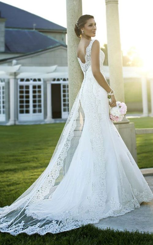 (Wouldn't need much of a veil) Pretty wedding dress that reminds me of Elsa's dress from Frozen!