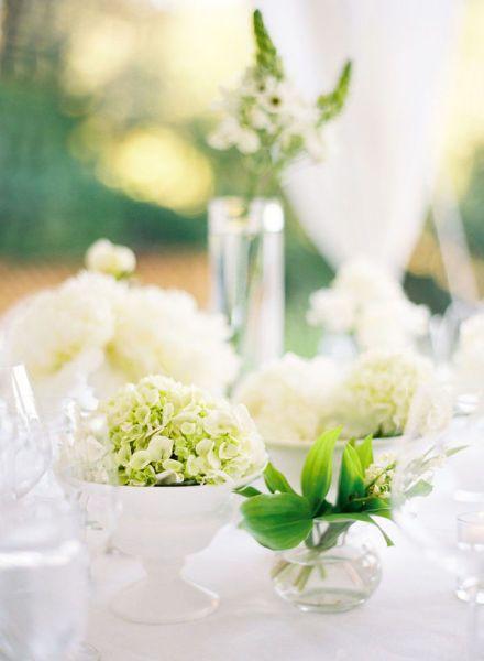 Green centerpieces in white bowls modern wedding