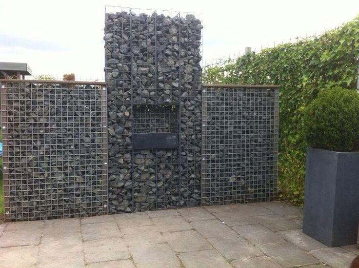 Een mooie afscheiding cre eren in de tuin een gelhaard van gabionen en stenen hoe leuk is dat for Tuin decoratie met stenen