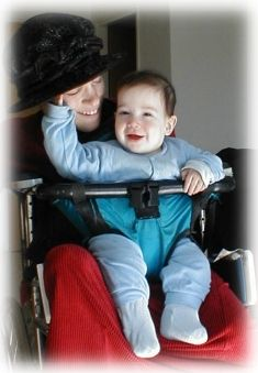 Malka and Avraham demonstrate their wheelchair infant-toddler carrier.